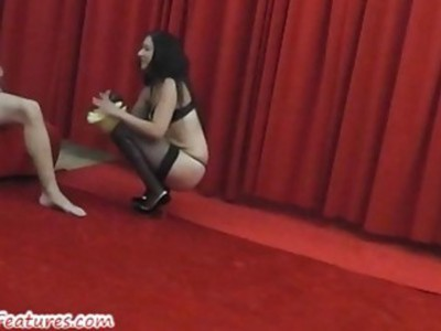 Gorgeous amateur chick gives backstage BJ to young guy
