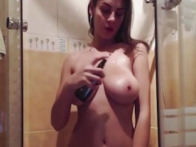 Brunette amateur with amazing natural melons masturbates in the shower