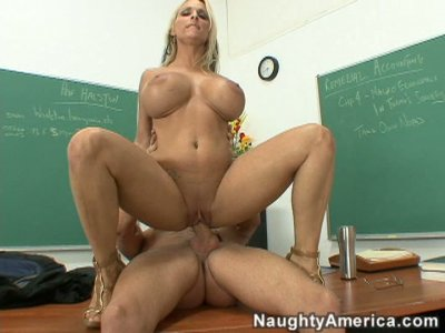Big jugs blonde milf Holly Halston sucks, gives titjob and rides cock.