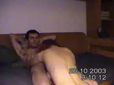German couple having steamy sex on the bed