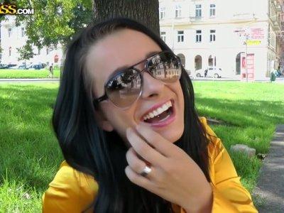 Communicative slutty brunette shows her butt outdoors