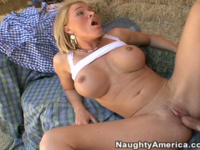 Blonde Krissy Lynn deepthroats and gets titfucked on the farm