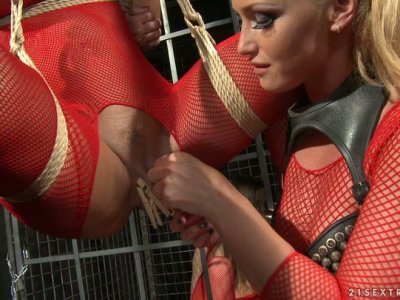 Christina Bella in fishnet suit gets fingerfucked by her mistress