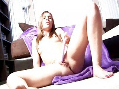 Cam slut spreads legs and shoves big dildo in pussy