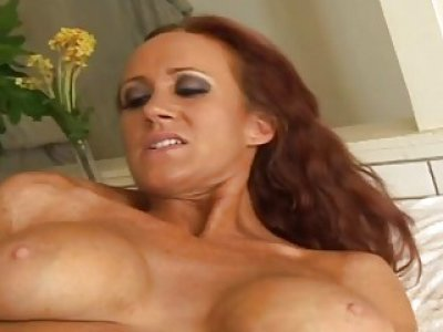 Busty redhead MILF masturbates with a dildo before stud fucks her pussy and butt