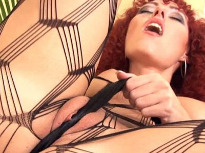 Lascivious redhead Shantie is toying her pussy