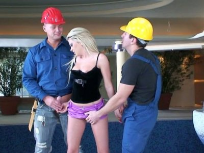 Bright cute blondie Alma Deluxe sucks two dicks of the workers