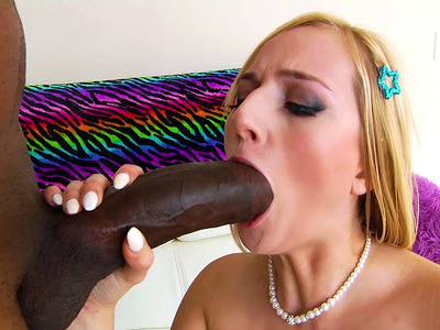 Kate England gives Dredd a two-handed, spit lubed blowjob