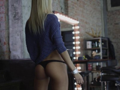 Blonde babe is slowly stripping down, showing her perfect body