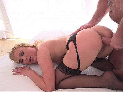 Doggy style anal with a blonde in stockings