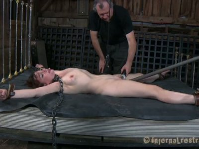 Ugly red-haired slut Maggie Mead gets drilled with dildo in BDSM sex video